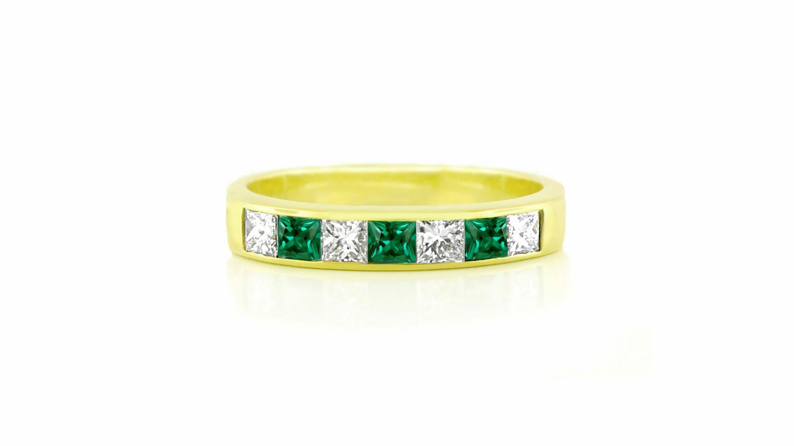 emerald & diamond channel-set ring set in 18ct yellow gold