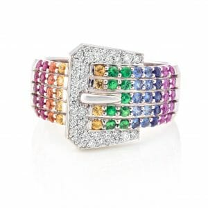 rainbow gemstone buckle ring | 58 precious gemstones of ruby, sapphire and tsavorite with 36 white diamonds set in 14ct white gold.