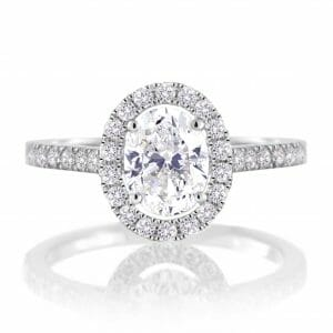 white sapphire & diamond halo ring set in 18 carat white gold