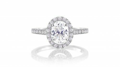 white sapphire & diamond halo ring set in 18 carat white gold