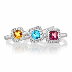 Diamond Halp Gemstone Stack Rings | A trilogy of gemstone stack rings including a citrine, blue topaz and pink tourmaline surrounded each by a halo of diamonds set in 18 carat white gold