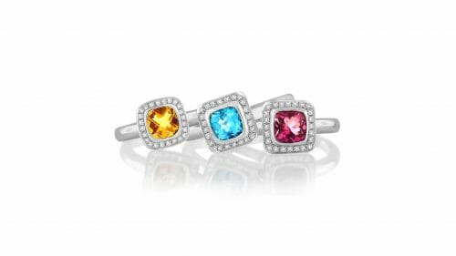 Diamond Halp Gemstone Stack Rings   A trilogy of gemstone stack rings including a citrine, blue topaz and pink tourmaline surrounded each by a halo of diamonds set in 18 carat white gold