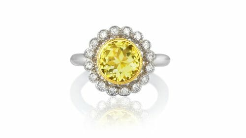 Danburite Daisy Ring | Danburite surrounded by a halo of white diamonds in 18 carat gold
