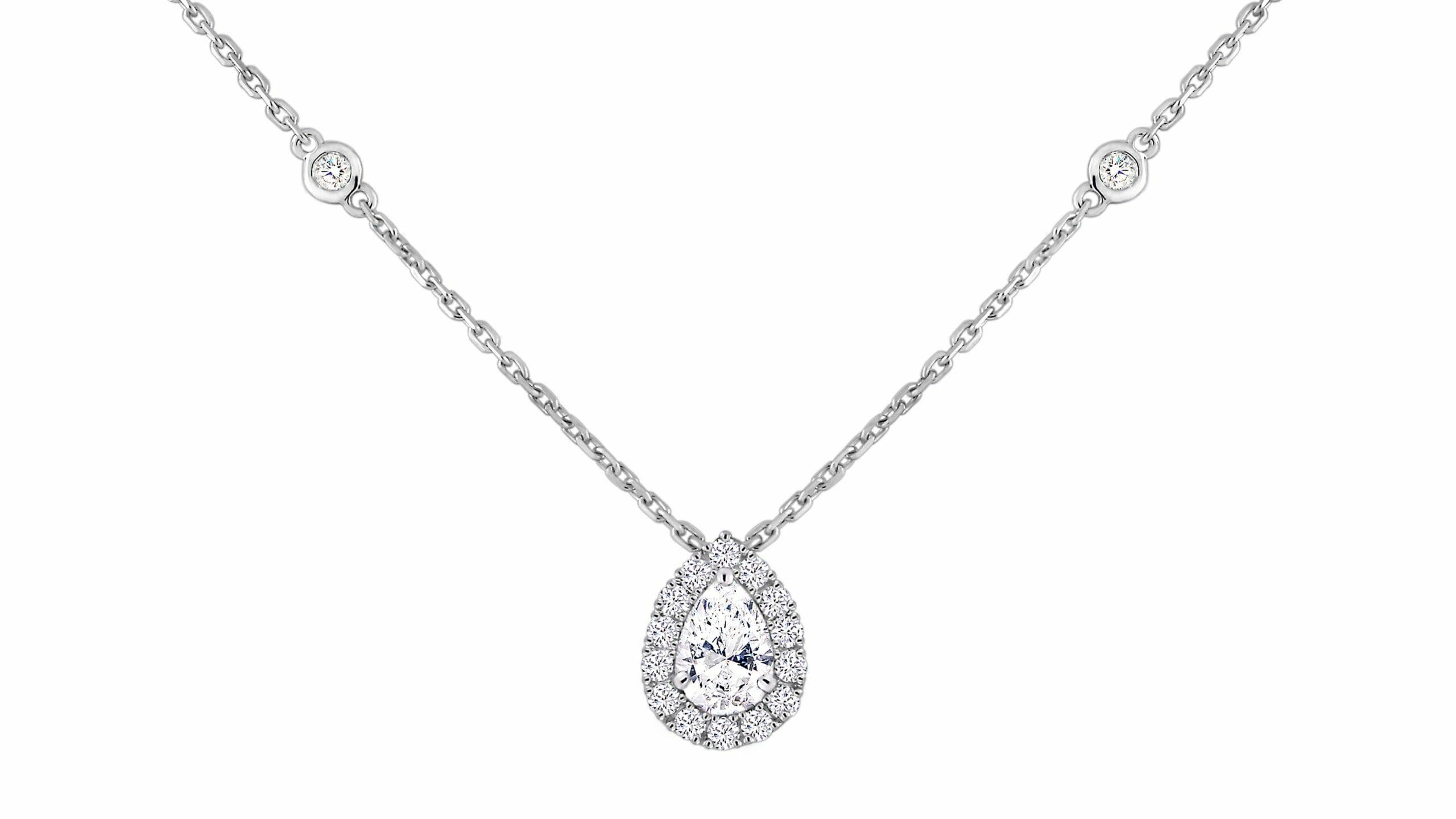 Diamond pendant | Pear diamond halo pendant set in 18 carat white gold