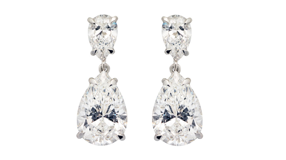A pair of platinum Teardrop diamond earrings set with pear-shaped diamonds.
