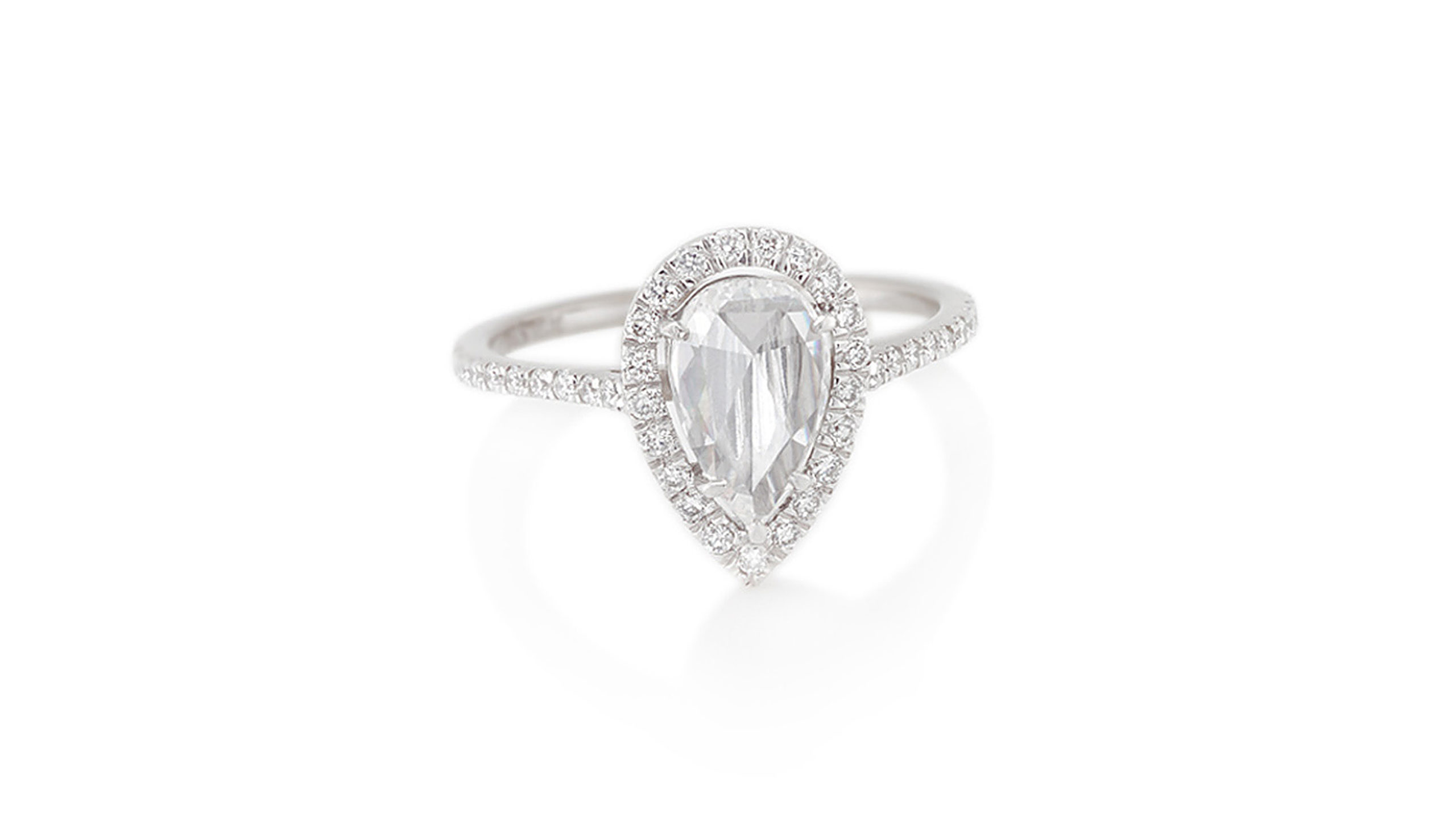 Rose Cut Diamond Halo Ring | A 0.90ct pear-shaped, rose cut fine white diamond, surrounded by a halo of 41 diamonds. Handcrafted in 18ct white gold