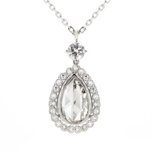 Rose Cut & Old Cut Diamond Drop Pendant | A beautiful vintage-style A 2.16ct antique rose cut diamond, surrounded by 0.62cts of small diamonds. Handcrafted in platinum