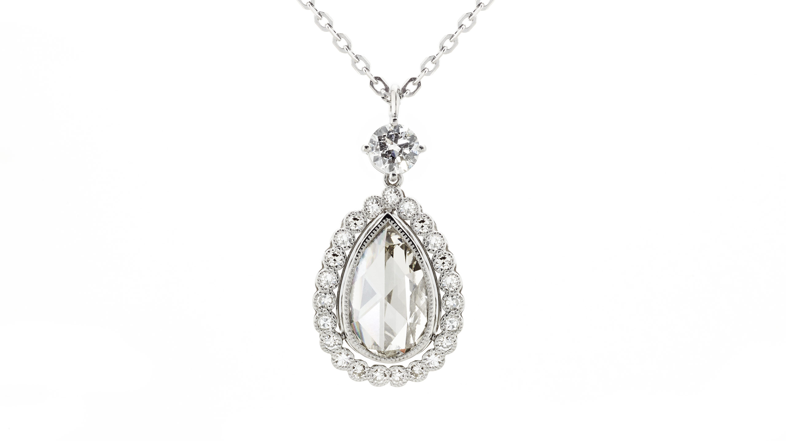 Rose Cut & Old Cut Diamond Drop Pendant   A beautiful vintage-style A 2.16ct antique rose cut diamond, surrounded by 0.62cts of small diamonds. Handcrafted in platinum