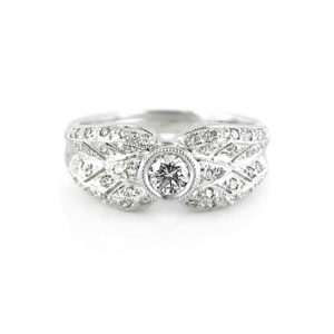 Round Brilliant Diamond Ring With Millgrain | A vinatge style diamond ring handcrafted in 18 carat white gold