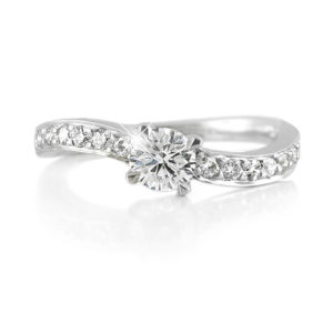 Round Diamond Ring with Curved Band | 18 carat white gold diamond engagement ring with gently curved band