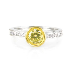 Tube-set yellow diamond ring | Set in 18 carat white and yellow gold