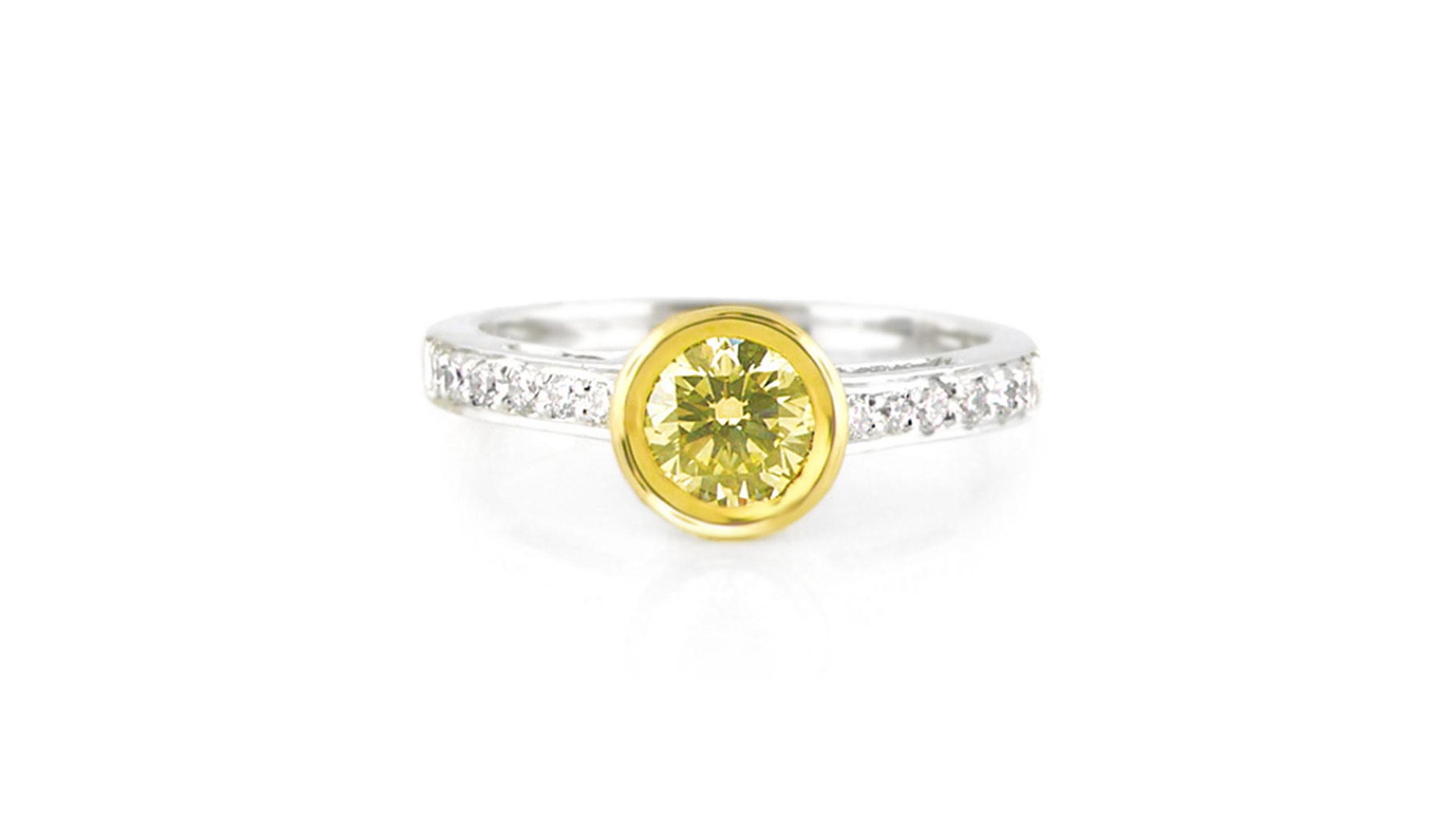 Tube-set yellow diamond ring | Set in 18 carat white and yellow gold