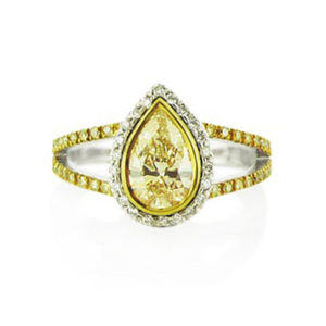 pear yellow diamond halo ring | Handcrafted in 18 carat white and yellow gold