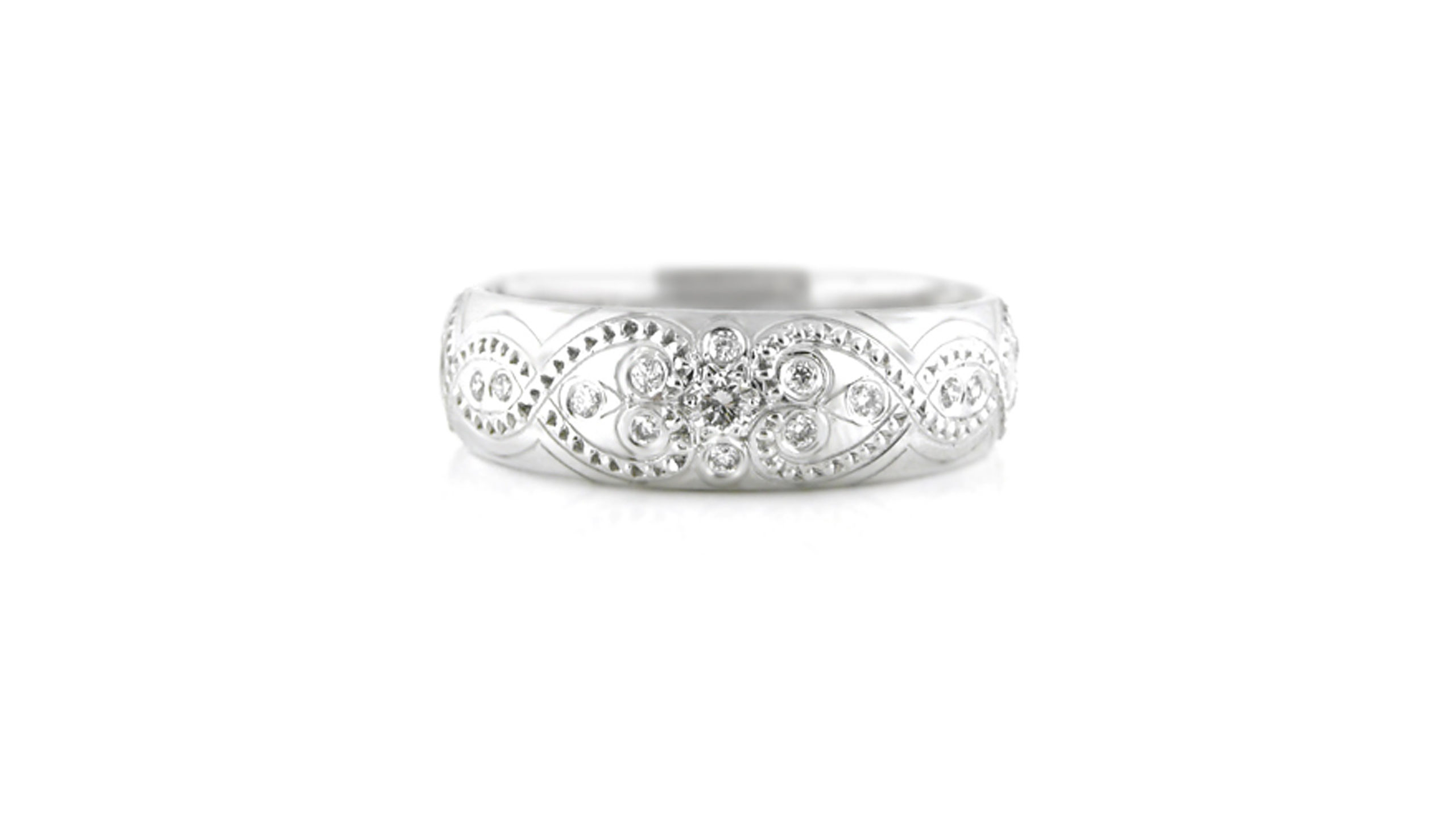 diamond ring with engraved band | A beautiful 18 carat diamond ring patterned with floral motifs and scrolls