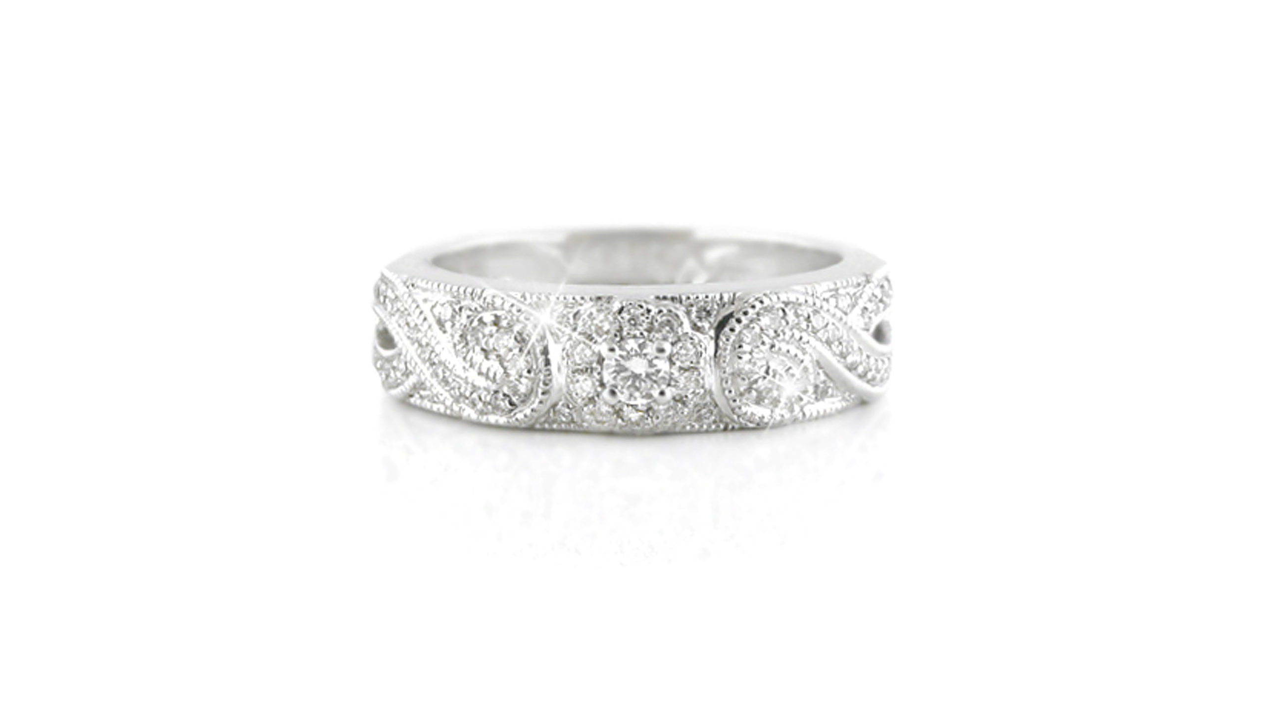 pavé-set diamond ring | 18ct white gold ring heralds a multiple of 71 pavé set diamonds in a vintage style patterned band with floral motifs, scrolls and millgrain detail