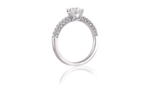 round diamond solitaire ring with micro-set band | An 18 carat white gold diamond solitaire ring with heart-shaped gallery and micro-set diamond band