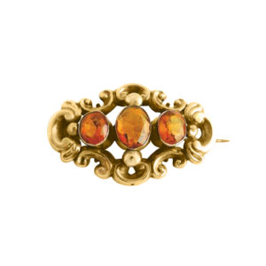 antique decorative brooch adorned with rich orange gemstones set in 9 ct yellow gold