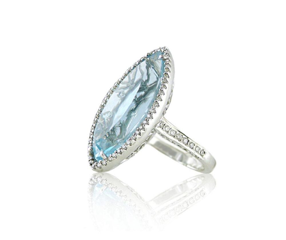 Blue topaz coloured gemstone and diamond halo ring