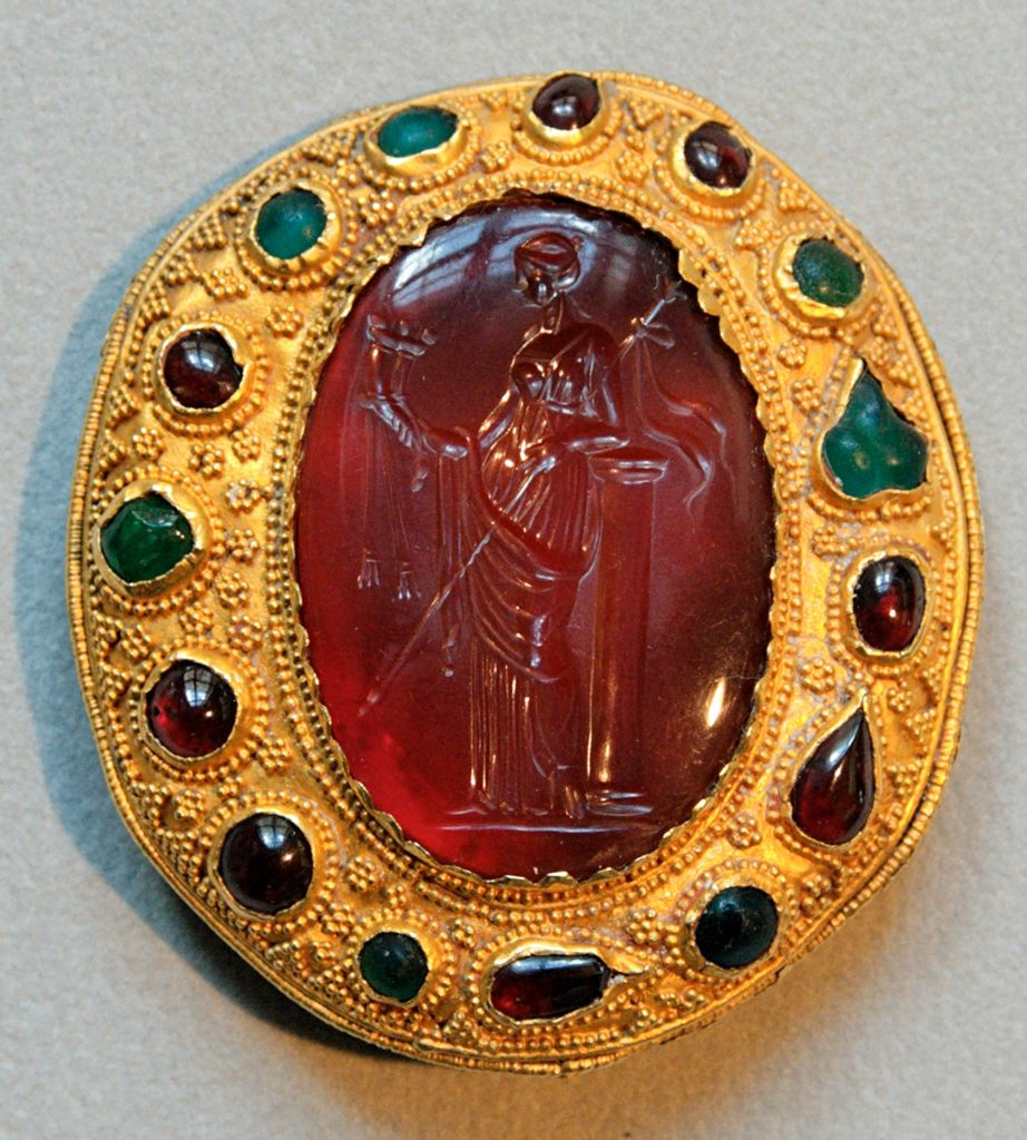 Gemstones | Carnelian intaglio with a Ptolemaic queen holding a sceptre, early 1st century BC; gold, garnet, emerald and glass paste mount, 1724 |  © Marie-Lan Nguyen / Wikimedia Commons