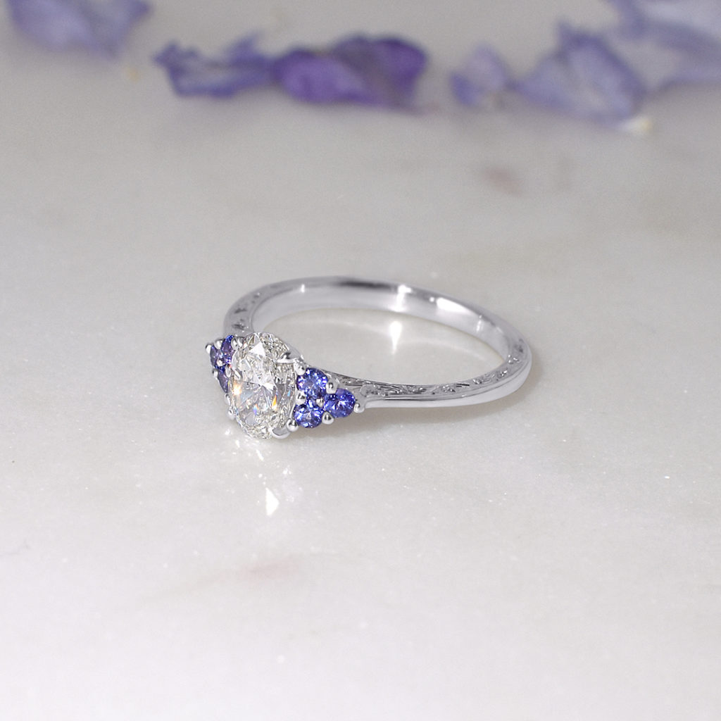 The custom made jewellery process | A custom design for a special client: Oval diamond & tanzanite engagement ring with a beautiful hand-engraved band.
