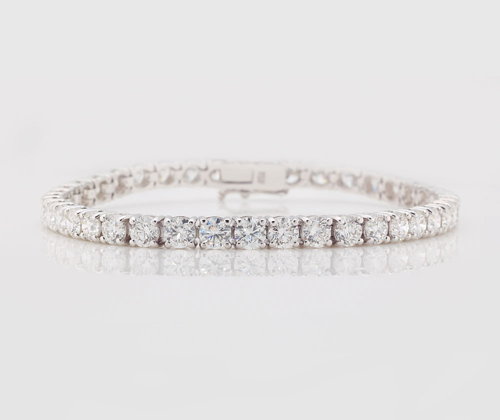 Diamond Tennis Bracelet  Our classic claw-set tennis bracelet set with 10.00cts of fine white diamonds. Mounted in 18ct white gold.