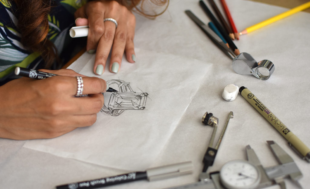 The custom made jewellery process | Our Jewellery Designer in the process of hand sketching a custom made 3 Stone Diamond ring