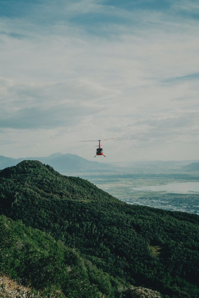 Place to propose in Cape Town: helicopter ride   Helicopter flying over moutnain range